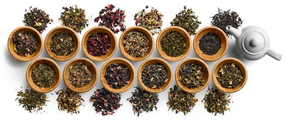 Large set of tea on a white background. The view from the top