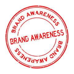 Grunge red brand awareness word round rubber seal stamp on white background