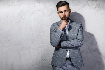 Handsome bearded man wearing gray checkered suit Wall mural