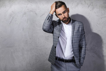 Handsome bearded man wearing gray checkered suit Fotobehang
