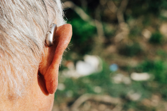 senior man wearing a hearing aid
