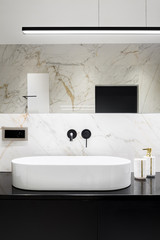Oval and white bathroom washbasin