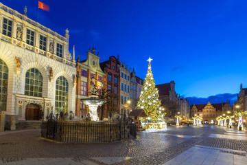 Beautiful architecture of the Long Lane in Gdansk with Christmas ligths at dawn, Poland.