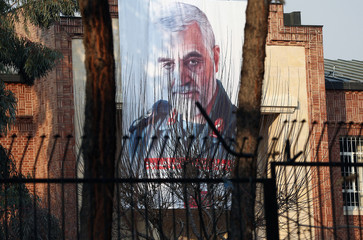 A picture of Iranian Major-General Qassem Soleimani, head of the elite Quds Force, who was killed in an air strike at Baghdad airport, is seen on the former U.S. Embassy's building in Tehran