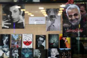 A picture of Iranian Major-General Qassem Soleimani, head of the elite Quds Force, who was killed in an air strike at Baghdad airport, is seen at a book store in Tehran