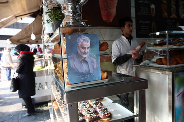 A picture of Iranian Major-General Qassem Soleimani, head of the elite Quds Force, who was killed in an air strike at Baghdad airport, is seen at a confectionery shop in Tehran