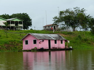 Floating houses on the banks of the Mamori River. Amazon, Brazil