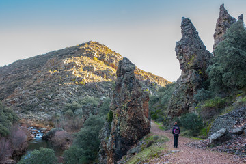 Hiker at the Three quarzite towers site at National Park of Cabaneros, Spain