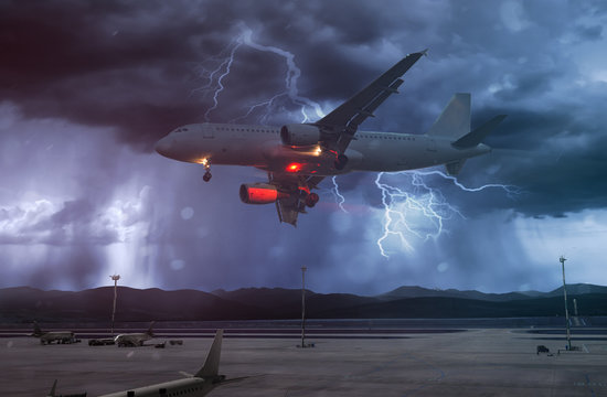 airplane flies in bad weather and storm with lightning bolt at airport