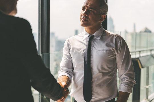 Business partnership successful meeting concept. Image businessman handshake. Business etiquette. Successful businessman handshaking after good deal.