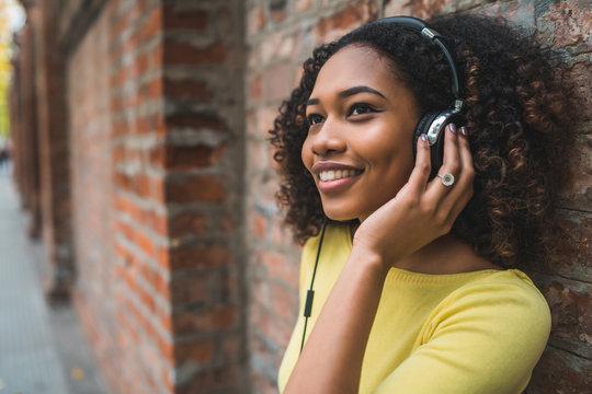 Afro american woman listening music