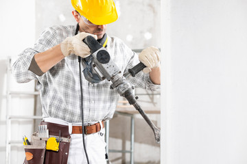 Builder drilling using an electric hand drill
