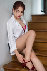 Portrait of asian sexy woman in the office,thailand people pose on stair for take a picture