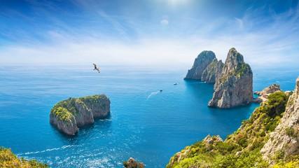 Fototapeten Blau Jeans Famous Faraglioni Rocks near Capri Island, Italy. Beautiful paradise landscape with azure sea in summer sunny day.