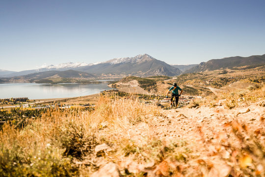 One man enjoying the splendor of the fall colors, mountain biking in Silverthorne. Summit County, Colorado.