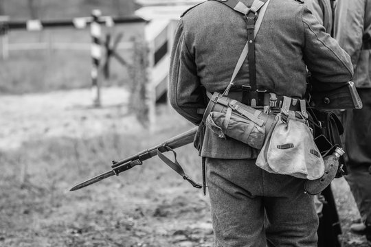 German soldier during the second world war in uniform with a rifle and bayonet with a knife. Black and white photography