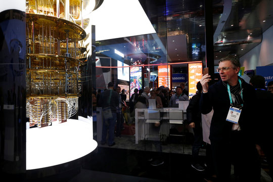 A man takes a photo of a model of the IBM Q System One quantum computer during the 2020 CES in Las Vegas