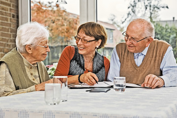 Elderly Couple and Dughter Making Plans