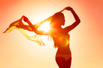 Wellness woman body silhouette curves dancing carefree with femininity with scarf flowing in the...