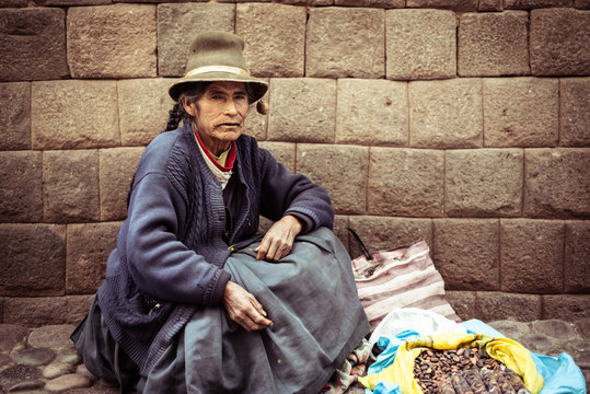 local homeless woman sells roasted beans on street