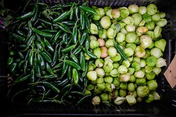 fresh organic produce in bin at farmers market