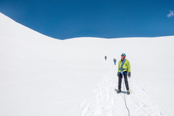 Men mountaineering on snowy landscape