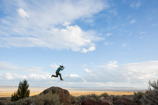 Humorous photo of man jumping from rock in the middle of the desert
