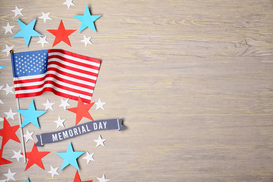 USA flag and stars on wooden background. Memorial Day celebration