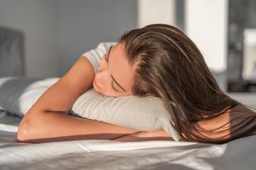 Sleeping on foam pillow bed Asian girl sleeping on stomach sleeper resting head on foam pillow. Hair care silk pillowcase. Good night sleep or midday nap.