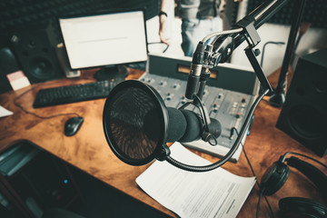 Radio station microphone in recording studio or broadcast room, working place of radio host, close up. Fotobehang
