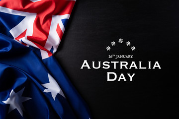 Australia day concept. Australian flag with the text Happy Australia day against a blackboard background. 26 January. Fotomurales