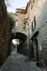 Castiglione della Pescaia, Grosseto, Tuscany, Italy, January 2, 2020 - Alley of the hilltop fortress. The modern city grew around a medieval fortress, and it is now a tourist destination.