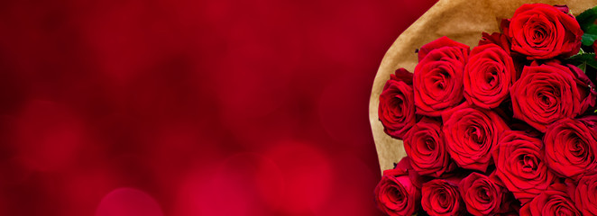Panoramic background with Bouquet of red flowers roses.