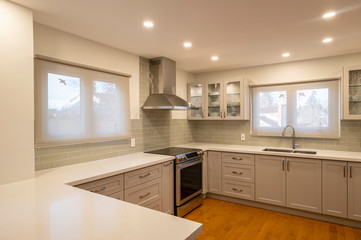 New and Modern Open Concept Kitchen with a Grey and White Color Scheme