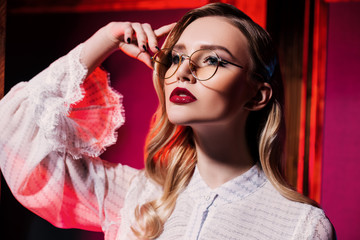 smart blonde with stylish glasses