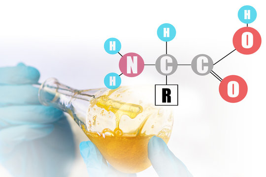 Amino Acid Formula. chemist works in a chemical laboratory. The development of sports nutrition with vitamins. Compounds of Amino Acids.