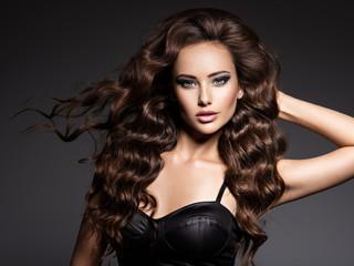 Spoed Fotobehang Kapsalon Beautiful woman with long curly hair