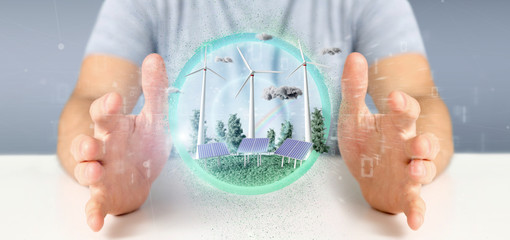 Businessman holding a Windturbines and solar panel producting clean energy - 3d rendering