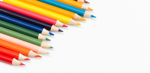 Multi color pencils. the concept of a multinational family and equality in the world.