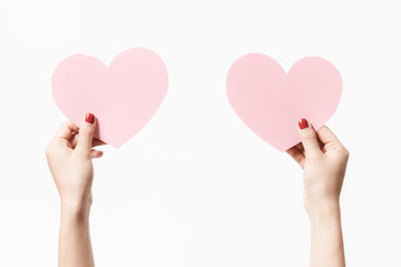Close up women holding pink blank  paper with heart shape on white background.