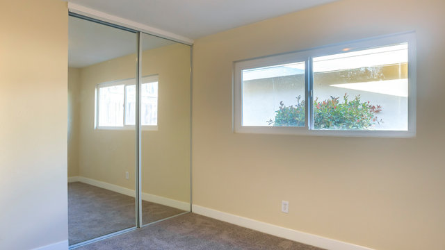 Panorama frame Empty bedroom with vacuumed carpet