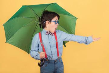 child with green umbrella