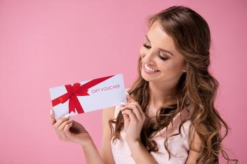 Beautiful woman giving a gift voucher