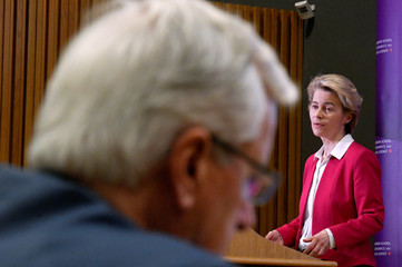 European Commission President Ursula von der Leyen speaks as European Union's chief Brexit negotiator Michel Barnier is seen in the foreground, at the London School of Economics in London