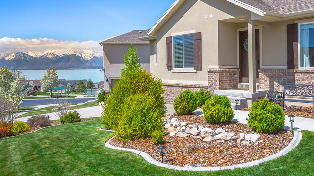 Pano Home with landscaped garden overlooking Utah lake and snowy Mount Timpanogos