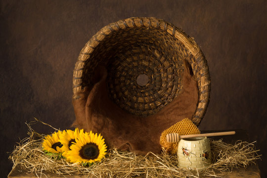Open beehive and sunflowers
