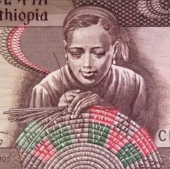 Ethiopian woman weaving basket on Ethiopia 10 birr banknote close up.