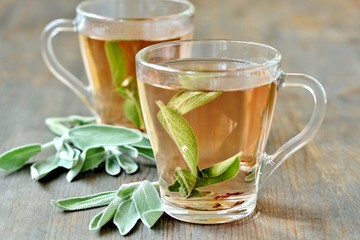 Foto op Aluminium Thee hot tea with sage. prevention and treatment of the common cold.