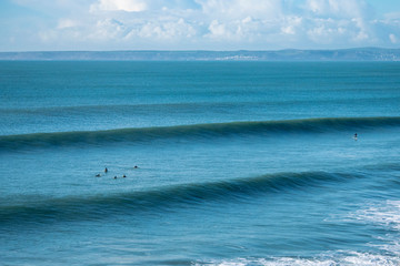 Surfers Waiting for Big Waves