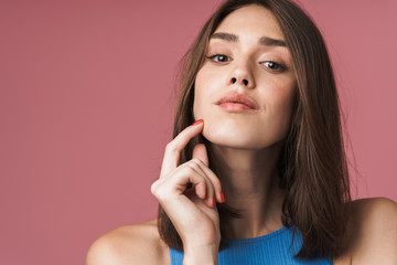 Wall Mural - Close up of an attractive young short brown haired woman